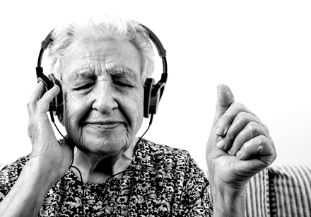 Lady Listening to Headphones small